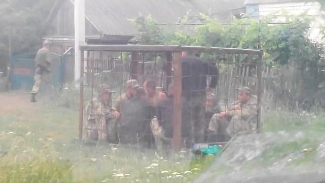 VID Ukrainian Soldiers Put In Cages For Boozing